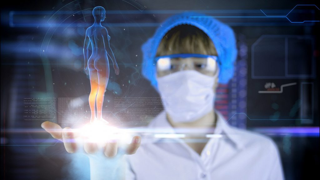 Female octor with futuristic hud screen tablet.Human body scan. Medical concept of the future